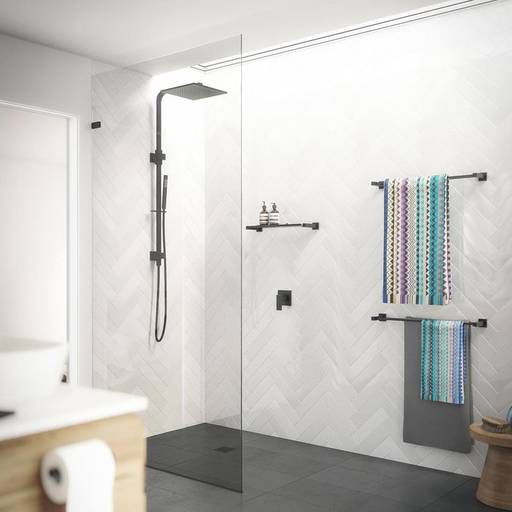 Recently we have been working closely with Robert Dukes from @rdvisualisation who has created some absolutely amazing rendered concept images of our range for us. This image features our popular combination king shower set with built in diverter, wall mixer, towel rails, floor grate and our brand new bathroom shelf (due to arrive this month!). We think this range of matte black tapware and accessories really make an impact against the marble look chevron tiles. #Meir #Meirblack…