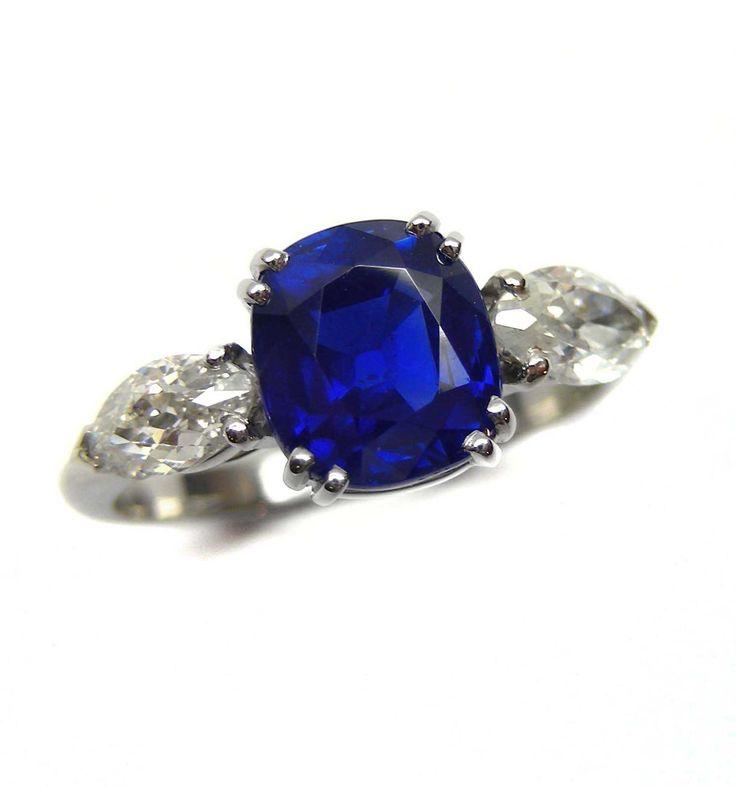 - Cushion cut sapphire and diamond three stone ring, the Kashmir sapphire weighing 2.46cts