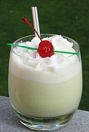 Scooby Snack Cocktail ~ Midori Melon Liqueur, Malibu Rum, Irish Cream, Banana Schnapps, Captain Morgan's Pineapple Rum, Half & Half  Whipped Cream, and a cherry to garnish