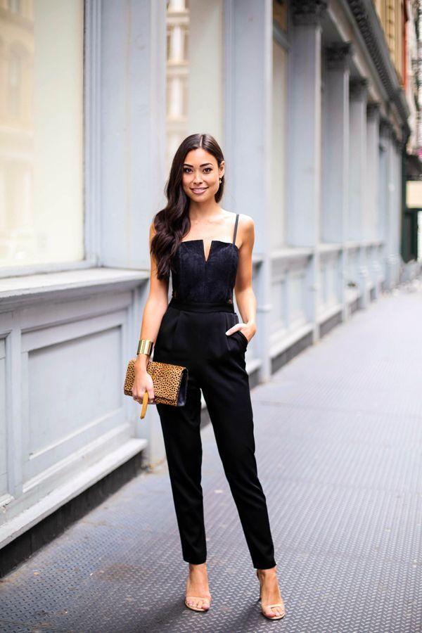 Shop this look for $66:  http://lookastic.com/women/looks/black-jumpsuit-gold-bracelet-brown-clutch-beige-heeled-sandals/5575  — Black Jumpsuit  — Gold Statement Bracelet  — Brown Leopard Leather Clutch  — Beige Leather Heeled Sandals