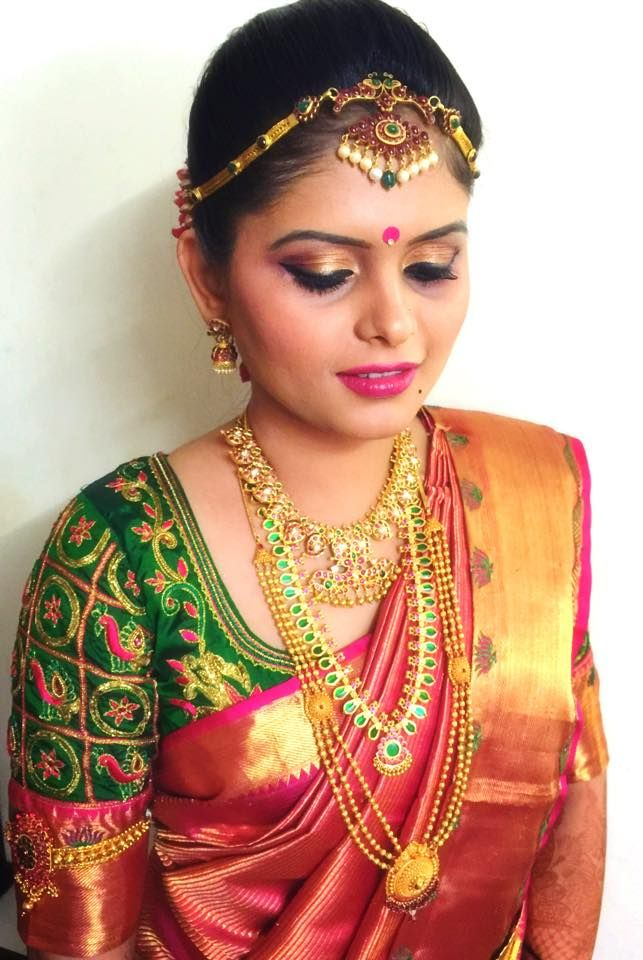 South Indian bride. Temple jewelry. Red silk kanchipuram sari with contrast green blouse.Braid with fresh flowers. Tamil bride. Telugu bride. Kannada bride. Hindu bride. Malayalee bride.