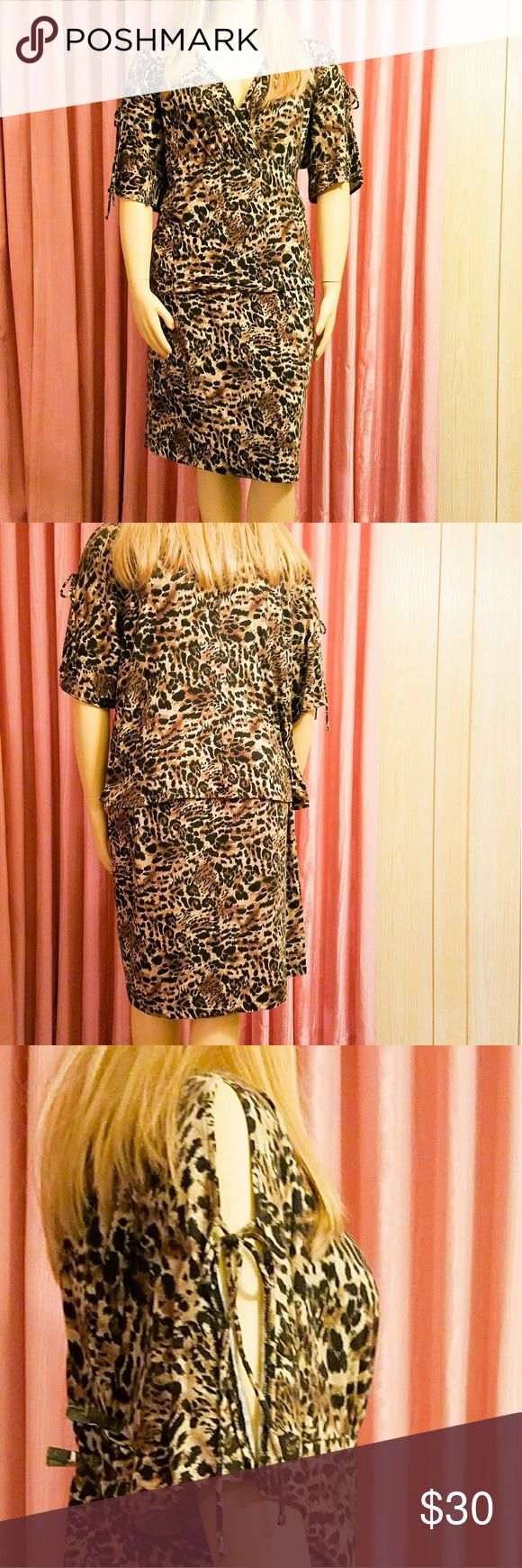 Plus size animal print two piece set in 18/20 Venezia  jeans brand SOFT animal print top with split sleeves in size 18/20 and a straight ,kirt with an elastic waistband. Very comfortable.  Sold as a set only.  Price firm. (Dress was pinned to fit model) Venezia Dresses