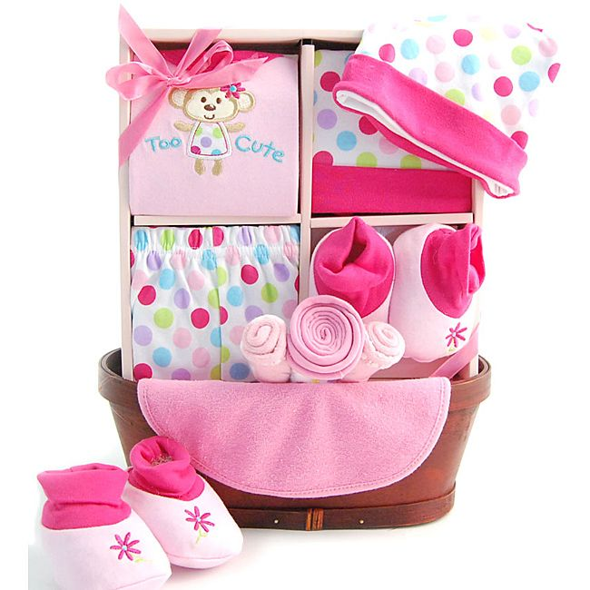 Send this adorable gift basket to the proud parents of a newborn baby girl. This gift basket contains a pair of pants, shirt, hat, booties, washcloth, socks, and bib.