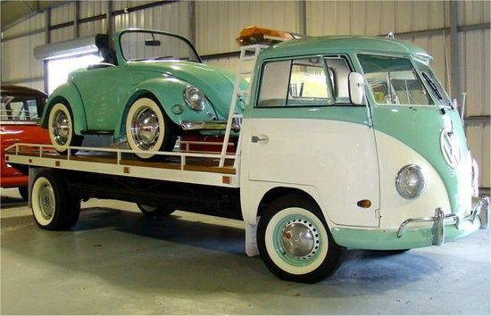 An Odd Pair. A Custom Stretched frame VW Kombi Flatbed Car Hauler w/ Micro Beetle in Tow. All color matching. Cool. want want want