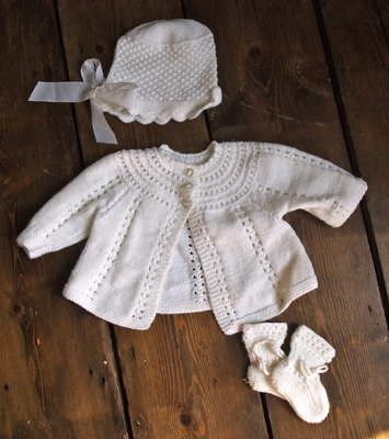 White Vintage Hand Knitted Cardigan Bonnet And Booties Set 16.00 Beautiful set of matching cardigan, bonnet and booties from our vintage clothes for kids. All hand-made from 100% wool, these would make a fabulous gift for a new-born.  Size - Newborn  Customise with some of our kids accessories