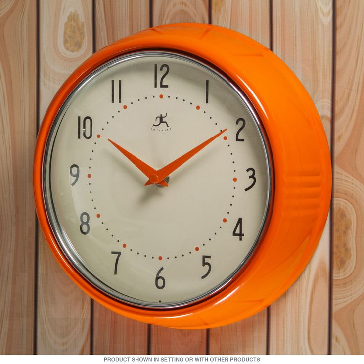 Add some orange to your kitchen decor with this Vintage-Style Orange Wall Clock. Perfect for retro rooms, this clock takes 1 AA battery and measures 9.5 inches in diameter.