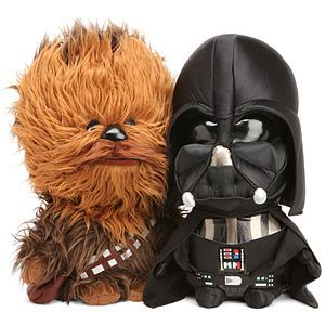 """Star Wars Plush with Sound.  From site pinned:  """"come in sizes from 4"""" keychain buddies all the way up to the mega huge 24"""" huggable Chewie. The 4"""" versions can be clipped to your keys, backback, laptop bag, or even the zipper of your winter coat. Each plush has a signature sound effect when you squeeze them: R2-D2 with his bleeps and bloops, Chewbacca with a Wookiee growl, Darth Vader's creepy stalker breathing, and Yoda with his patented advice for young Jedi-to-be.""""  Also Boba Fett…"""