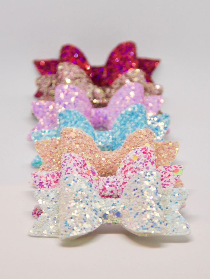 Medium Sized Glittery Sparkly Hair Bows.   In this set you will get:  1 White Winter In Wonderland Glitter Bow  1 Baby Blue Glitter Bow 1 Violet Glitter Bow 1 Peachy Pink Glitter Bow 1 Cupcake Sprinkles Glitter Bow  1 Princess Pink Glitter Bow  1 Rose Gold Glitter Bow  Can be sold as a set or separately.