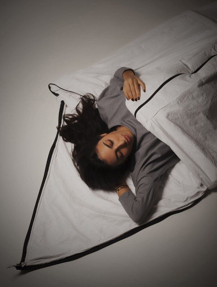 Students at the Royal College of Art have designed a garment that can turn into a shelter for an adult and a child