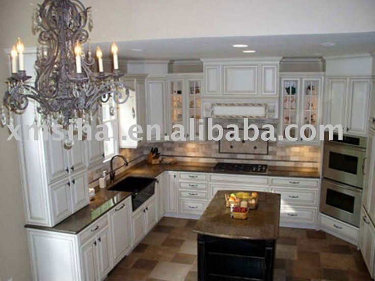 Tropical Brown Granite White Cabinets Dark Tile Floor