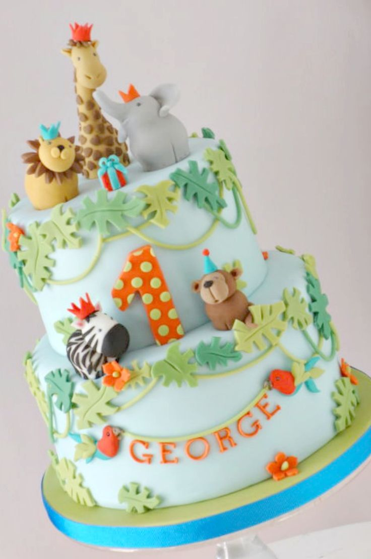 Jungle safari cake...love the body shapes and leaves