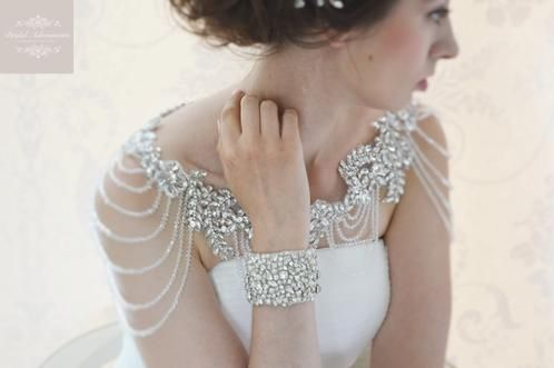 Accessorise your stunning Wedding Dress with this luxury sparkly crystal bridal shoulder accessories/bolero. The lace seems to float beautifully across your shoulders. We don't have enough words to describe how gorgeous this piece is. Available in one Size.
