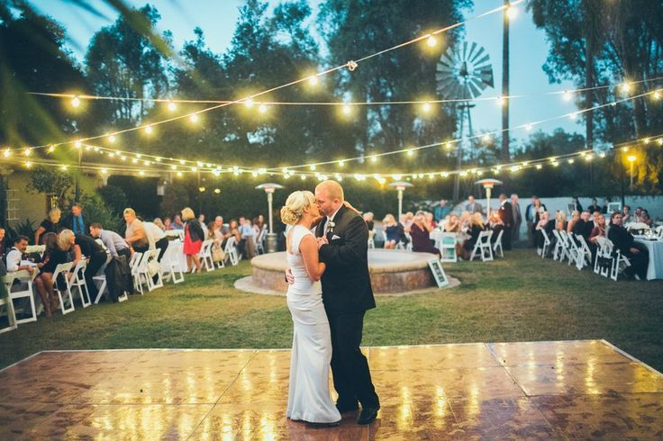 Outdoor dance floor with string globe lights (very Big Fish) -- yes! #love ahh no, jk this is totally where we are going to have the games #nailedit