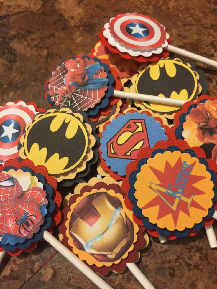 New...Superheroes Cupcake Toppers. This listing is for (12) cupcake toppers in an assortment of all your favorite superheroes. All toppers come in each characters coordinating colors and attached to a white lollipop stick. You can have one theme or a variety~~banners and packages also available~~ Toppers are printed on premium cardstock and attached to two scalloped circles.