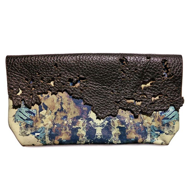 Rust inspiration small clutch. Made from a mix of natural leather and printed…