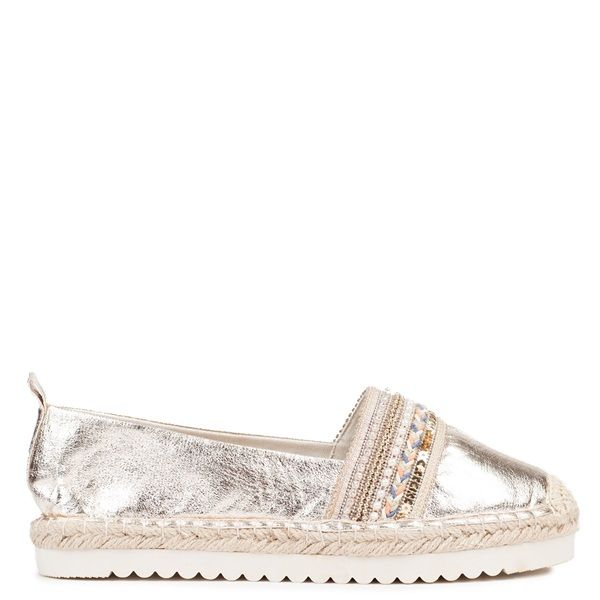 Gold metallic espadrille with white cleated sole. Features decorative rhinestones, beeds, sequins and colorful rope.