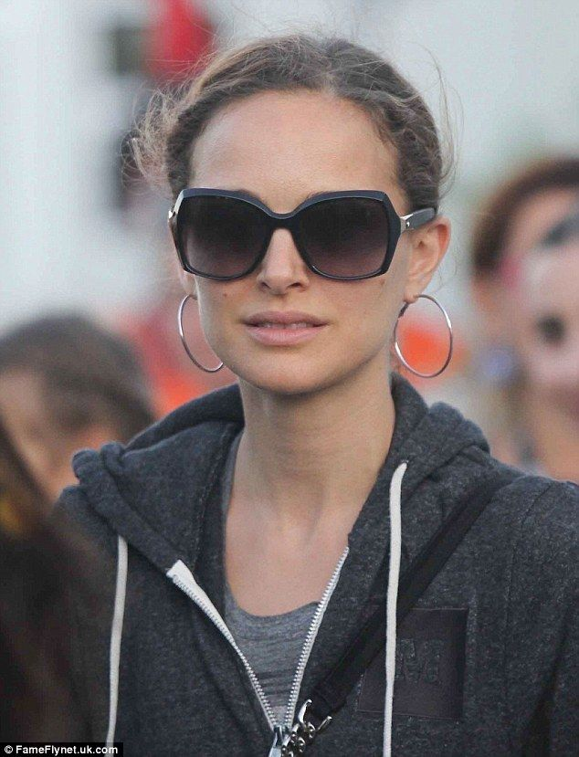 Covered up: The actress wore oversized shades and a charcoal hoodie perhaps to avoid being...