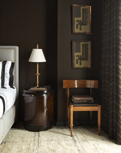 steven gambrel masculine modern bedroom--dark brown walls, upholstered bed, abstract art