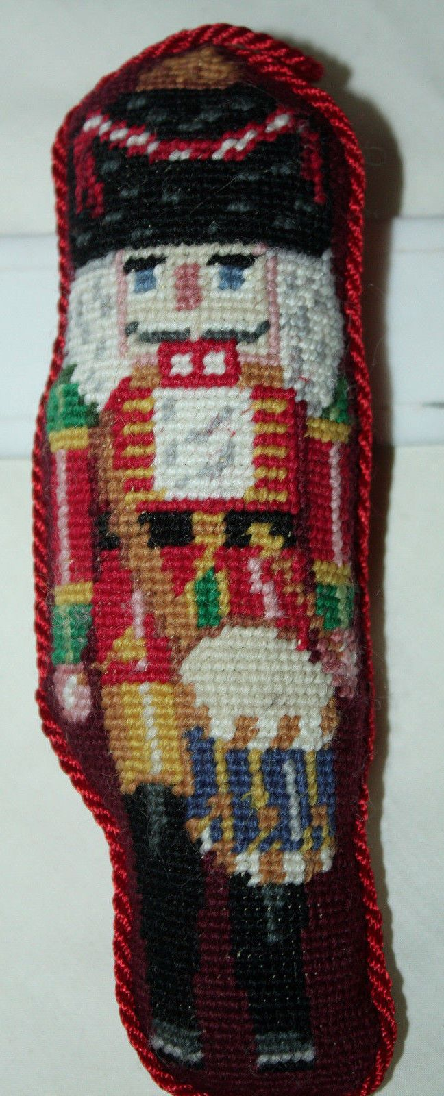 """Vintage Katha Diddel needlepoint ornament - red uniformed nutcracker drummer FOR SALE • $8.99 • See Photos! Money Back Guarantee. Vintage Katha Diddel needlepoint ornament - red uniformed nutcracker drummer - red cotton backing, red braid binding continues as a hanger at the top - 6 1/2"""" tall by 2 322765513820"""
