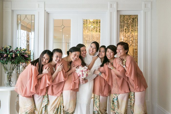 Bridesmaids in blush pink. Photo by Eric Ooi Studio. www.theweddingnotebook.com
