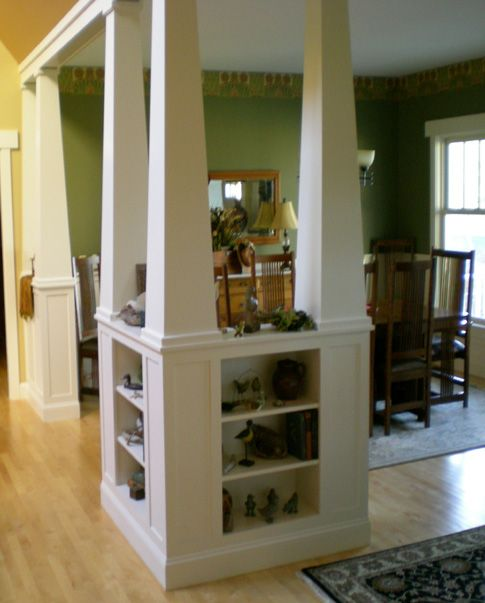 columns and bookcases define a semi-open floor plan. The paint colors and craftsmen details are nice as well.