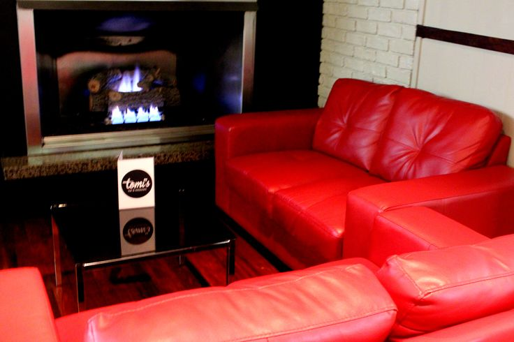 Tomi's couches by the fire place