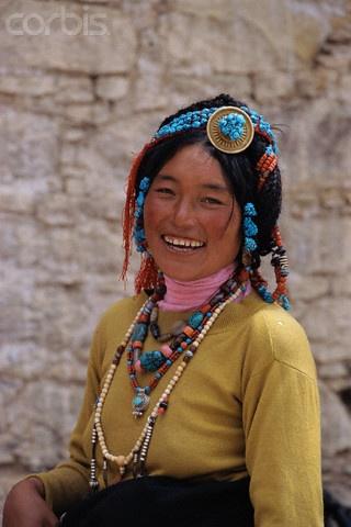Smiling Tibetan woman wearing traditional jewellery. Lhasa ...