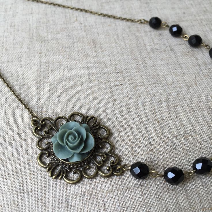 A personal favorite from my Etsy shop https://www.etsy.com/listing/234527570/black-glass-bead-necklace-with-grey