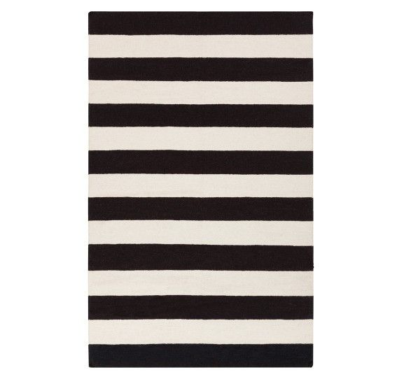 A black and white bold striped rug is an essential, especially if you're going for a Scandinavian interior.