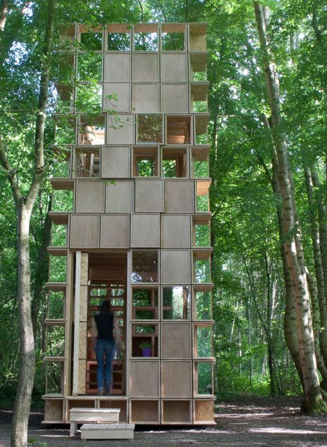woodland observatory by architecture collective CLP Architectes is a patchwork of square wooden panels and windows.
