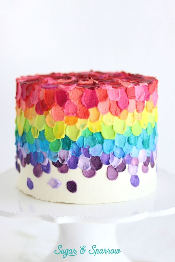 A Spatula Painted Rainbow Cake Featuring Buttercream Colored With