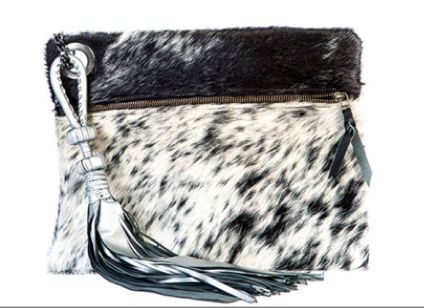 A stunning clutch bag with a beautiful and unique tassel– sexy and effortlessly stylish. An amazing example of rebranding Africa and tribal glam. Hand made in Kenya from cow hide and leather, with an attached leather tassel. Height: 25cm Length: 32cm Weight: 452g £270