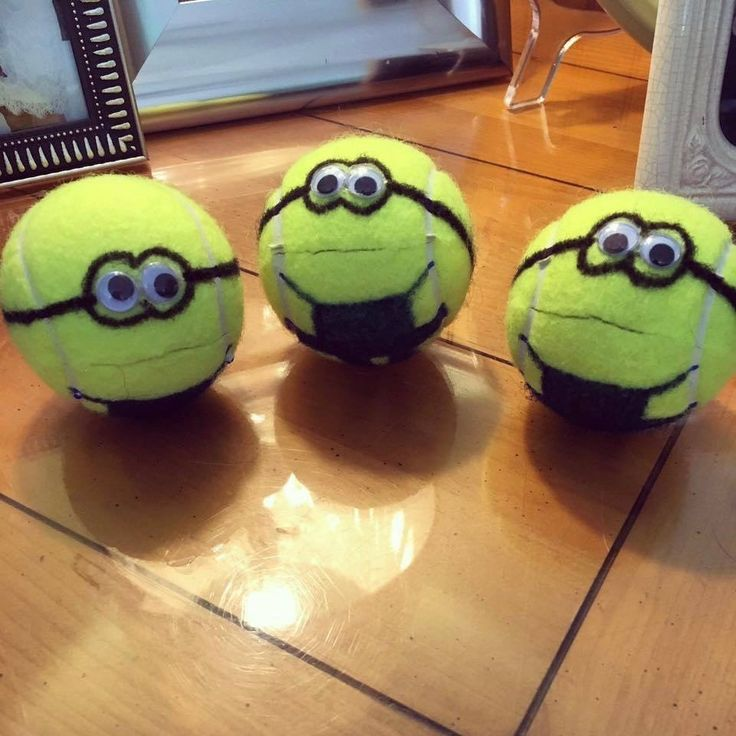 Cut slit in tennis ball and child squeezes and holds mouth with one hand and feeds marbles, coins, etc with other.