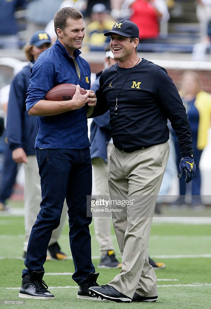 Quarterback Tom Brady of the New England Patriots laughs with head coach Jim Harbaugh of the Michigan Wolverines after they played catch before a game against the Colorado Buffaloes at Michigan Stadium on September 17, 2016 in Ann Arbor, Michigan.