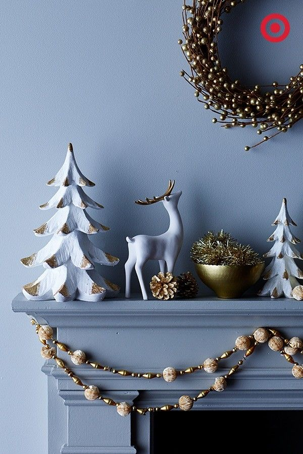 Tis the season for festive gold and white décor. These statement-making neutrals will make your holiday mantel shimmer and shine.