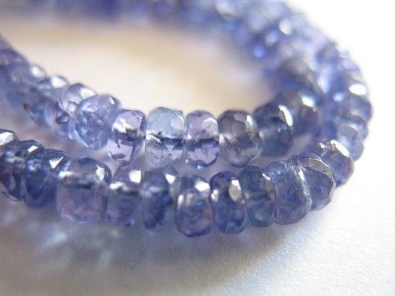 ** see storefront re: sale about 2.5-3 mm .. could be hair smaller or larger  For all TANZANITE RONDELLE.. faceted or smooth.. small to jumbo .. see http://www.etsy.com/shop/FabulousRocks/search?search_query=tanzanite+rondelles+solo  ~~~~~~~~~~~~~~~~~~~~~~~~~~~~~~~~~~~~~~~~~~~~~~~~~~~~~~~~~~  Stunning!! Tanzanite has a color like none other.. beautiful periwinkle purple blue.. Originally made popular by renown jeweler, Tiffanys in 1969 this high end designer gem ...