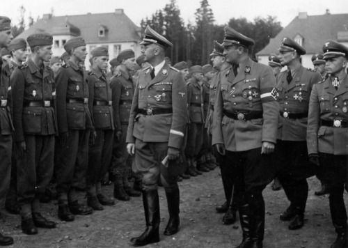 Reichsführer-SS Henrich Himmler inspects recruits into newly formed Hitlerjugend Division at Kaiserslautern Barracks in May 1943. The new division was formed around a nucleus of experienced officers and NCOs from the Leibstandarte Division, such as Fritz Witt, Kurt Meyer, Max Wünsche and Wilhelm Mohnke. It would be up to these men to mould the Hitlerjugend into a potent combat unit.
