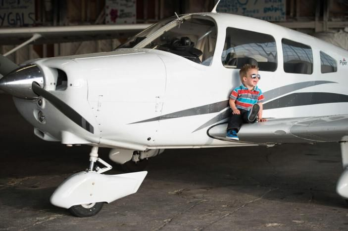 Natural light family photography in Regina Flying Club in Regina, SK with Courtney Liske Photography