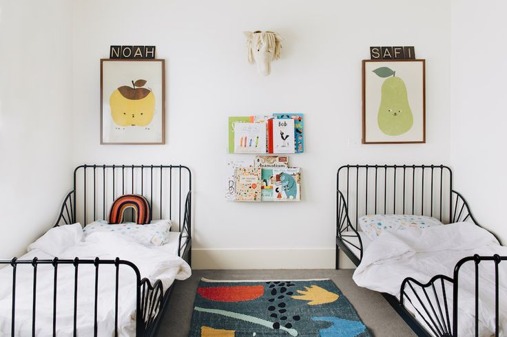 shared toddler boy room w/ IKEA twin beds + picture ledges for books