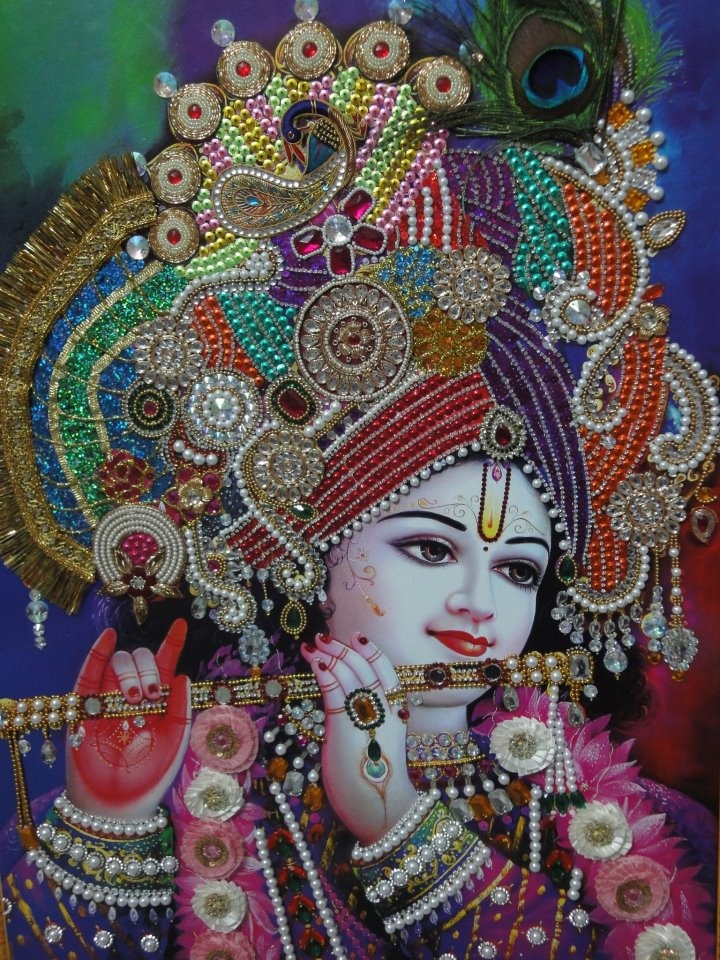 Among one of the most beautiful pictures of Krishna is this. The vibrant colors in the picture brings out our life where different colors make our life beautiful.