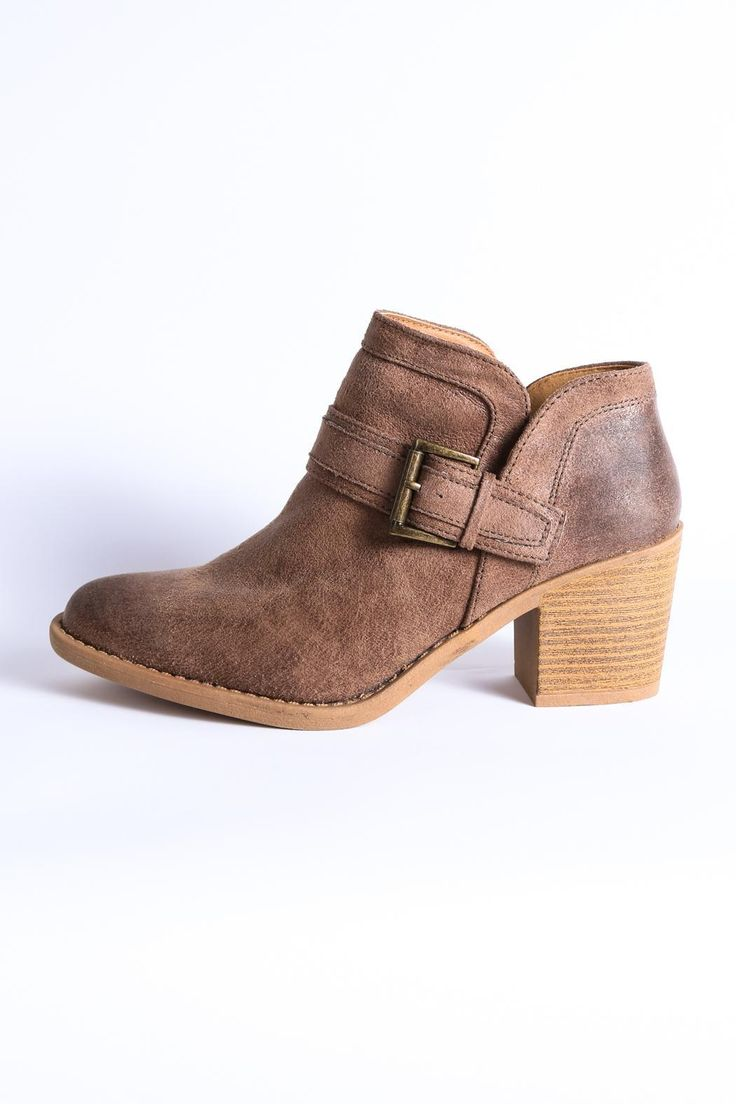 """Our Tobin Buckle Boot is what every girl needs in her closet. The cracked leather look, chunky heel, and buckle detail make this shoe an all-time favorite. It's comfortable for long walks and wearable all year long.Toe: Almond. Style: Everyday/Boho. Closure: Slip on. Wraparound buckle detail. Distressed look. Chunky heel. Width: Narrow toe.    Dimensions:2.75"""" heel height. 4.5"""" shaft height.   Tobin Buckle Boot by Qupid. Shoes - Booties - Heeled Georgia"""