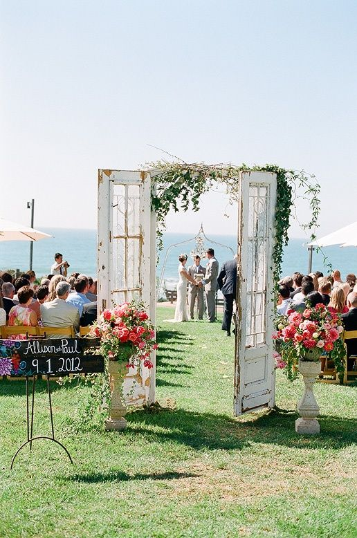 love the rustic double doors to the outdoor ceremony
