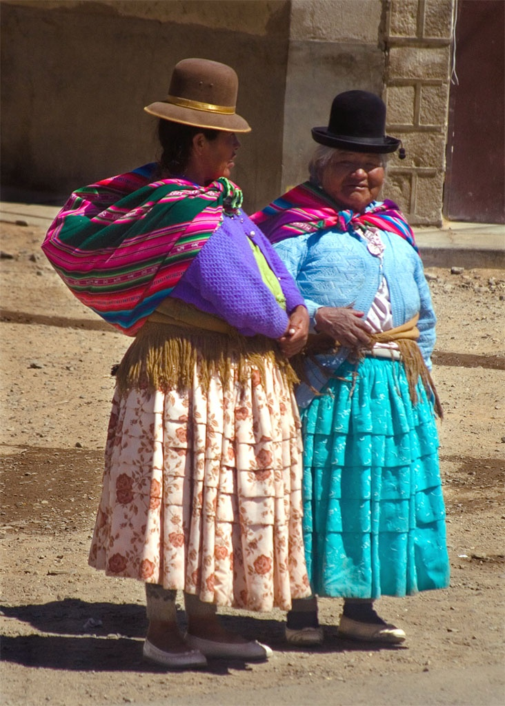 Aymara women, El Alto, Bolivia. Both the Aymara and the Quecha people live in Bolivia. Aymara women wear skirts that are slightly lower in the front than in the back.