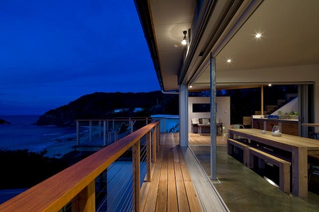 You don't often see a beach house that blends the indoors with the outdoors as well as this compact little gem on the mid-north coast of NSW. Designed by Bourne Blue architects to be a compact and simple holiday home for its owners, the structure is made up of three pavilions, with landscaping in between to minimize the scale and bulk of the building. The roof structure has been stepped to reduce bulk when viewed from the beach below. Simple, economical and corrosion resistant materials