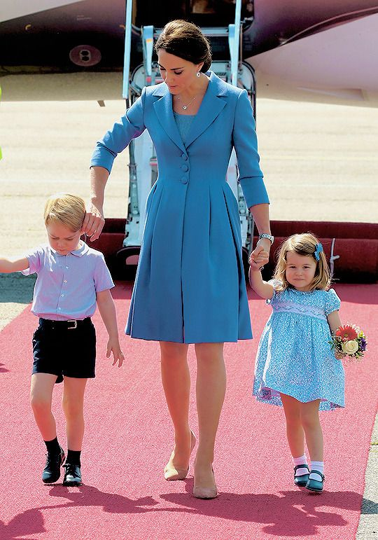 """ Catherine, Duchess of Cambridge, Prince George and Princess Charlotte arrive at Berlin Tegel Airport during an official visit to Poland and Germany on July 19, 2017 in Berlin, Germany. """
