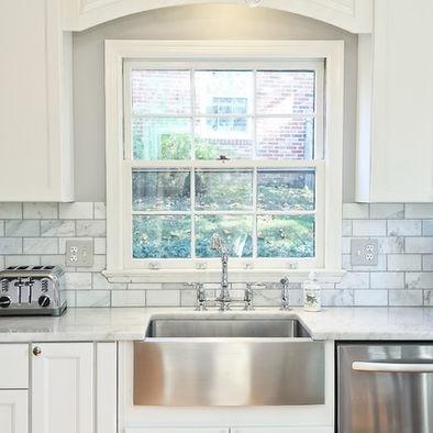 steel sink. backsplash. white kitchen. grey paint.