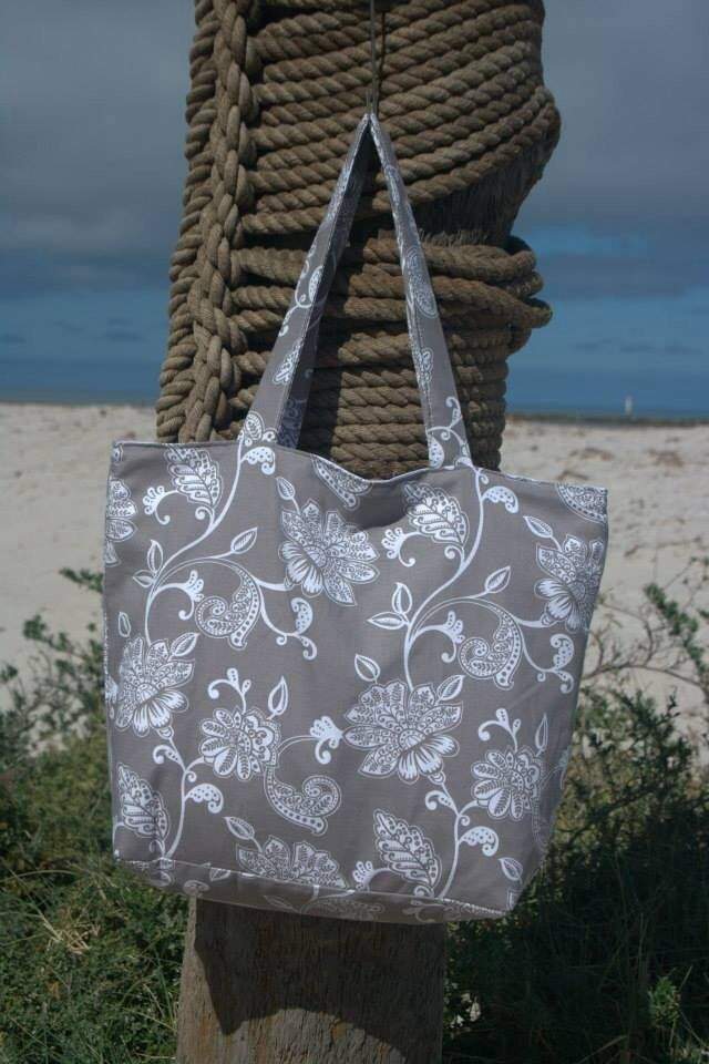 Taupe floral beach bag lined with white cotton fabric. Outer made from exterior upholstery fabric.  Measures approx 51x41x15cm. $30.00 each