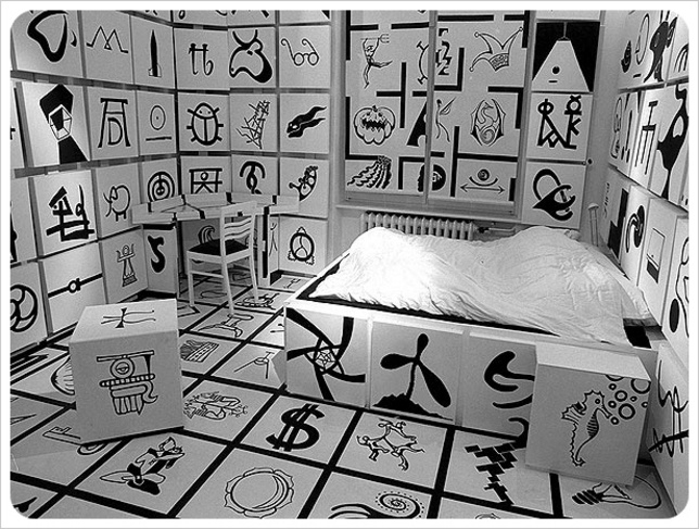 Bored with the idea of a traditional guest room, Storschen created different themes for each of the four rooms. Inspired by Jules Vernes' science fiction novel, Propeller Island, Storschen's guestrooms-cum art installations, like Symbols (A room filled with 300 symbols) became an extension of his career as an artist.     Read more: http://www.dwell.com/slideshows/propeller-island-hotel-berlin.html?slide=1=y=true#ixzz1sWsNx3lY