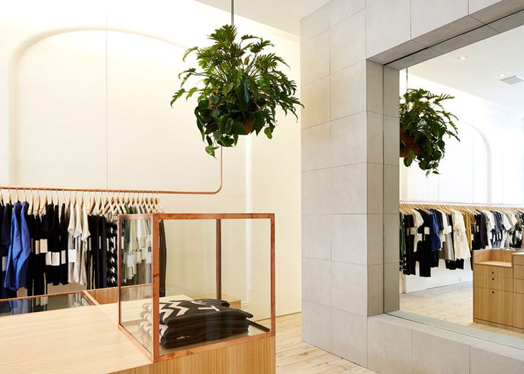 Kloke retail interior with copper clothes rails by Sibling | Dezeen