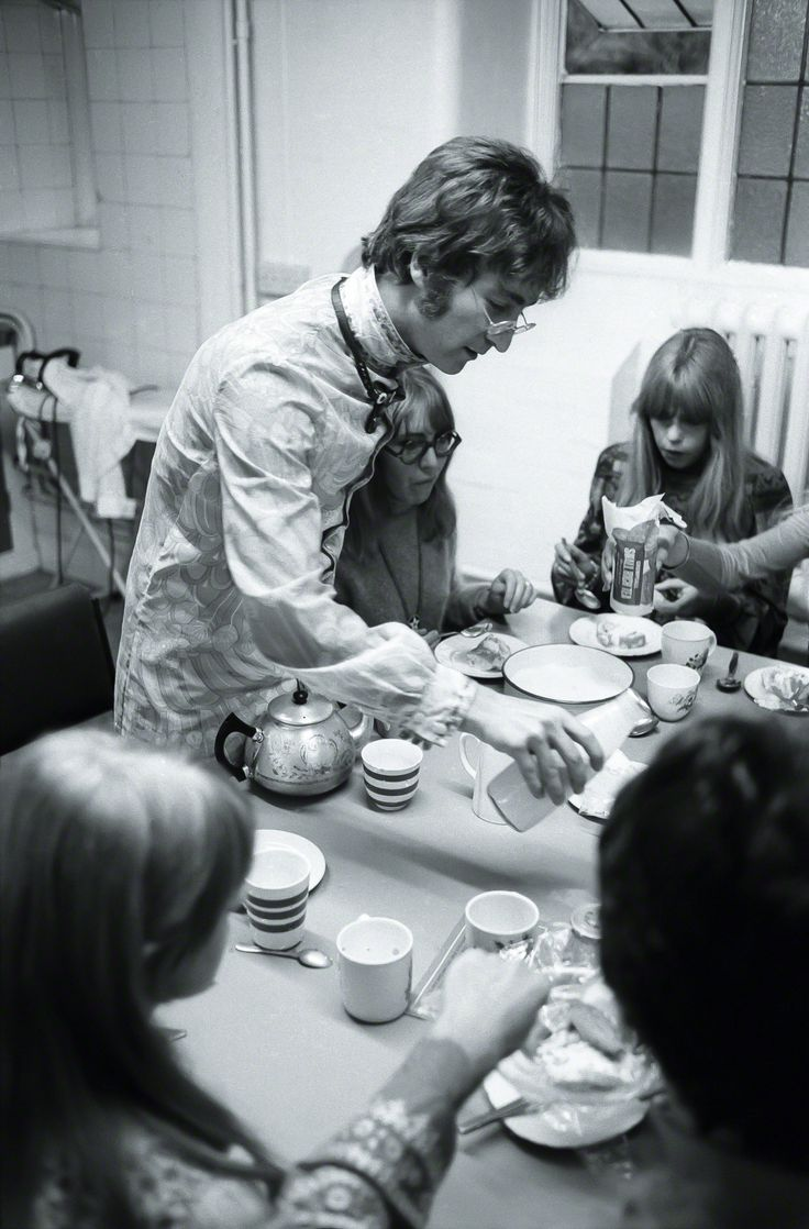 The Beatles and their partners have a meal together during their retreat at a transcendental meditation course conducted by Maharishi Mahesh Yogi at Normal College, Bangor, Wales, photographed by Henry Grossman. (August 26th, 1967)